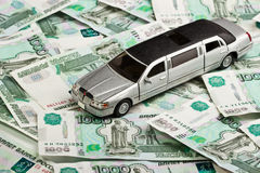 Toy car on money background Royalty Free Stock Images