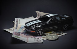 Toy car on money, on a black background. Stock Image