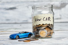 Toy car, money and card. Royalty Free Stock Photos