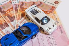 Toy car, money, insurance policy on the table. Car insurance concept. Toy car, money, insurance policy on the table, Car insurance concept stock photography