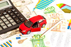 Toy car, money and other staff Stock Images