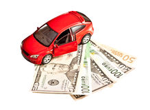 Toy car and money over white Stock Photos