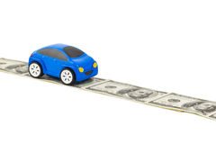 Toy car on money road Royalty Free Stock Photos