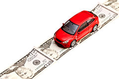 Toy car on the money road, isolated on white Royalty Free Stock Photo