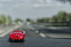 Toy car on the motorway. View of toy car on the motorway royalty free stock photo