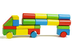 Toy car, multicolor truck wooden blocks transportation cargo. Toy car, multicolor truck wooden blocks transportation, cargo delivery, isolated white background Royalty Free Stock Image