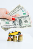 Toy car over a stack of coins Royalty Free Stock Photos