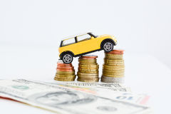Toy car over a stack of coins royalty free stock photography
