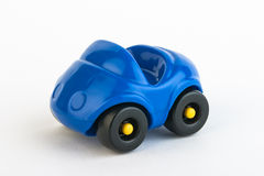 Toy Car. Toy plastic blue car on white background stock image