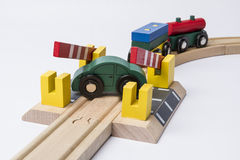 Toy car on railroad crossing Stock Photo