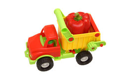 Toy car. Red pepper in the back. View from above Stock Photography