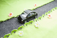 Toy car on the road. Royalty Free Stock Image