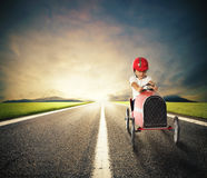 Toy car on road. Child with a toy car drives on a country road stock photography