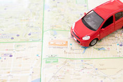 The Toy car on a road map Stock Photos