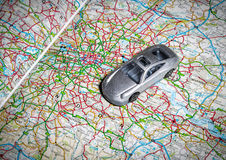 Toy car on road map. Image of a toy car on a road map stock image