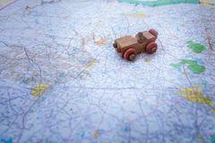 Toy car on a road map. Wooden old toy car on a state road map of Texas Stock Photography