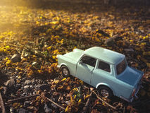 Toy car on the road nature background ,vintage filter.  royalty free stock images