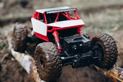 Toy car roading on wooden beams through mud Royalty Free Stock Photography