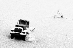 Toy car in sand. On the beach stock images