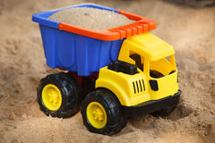 Toy car in sandbox Royalty Free Stock Images