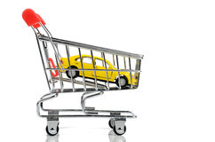 Toy car and shopping cart Stock Photo