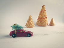 Toy car with a small Christmas tree on the roof Royalty Free Stock Photo