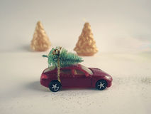 Toy car with a small Christmas tree on the roof Royalty Free Stock Photography