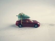 Toy car with a small Christmas tree on the roof Royalty Free Stock Photos