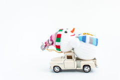 Toy car with snowman on white. Background Stock Photos