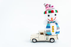 Toy car with snowman on white. Background Stock Images