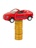 Toy car and stack of coins Royalty Free Stock Images