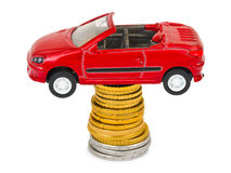 Toy car and stack of coins Stock Images