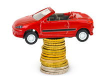 Toy car and stack of coins Stock Photos