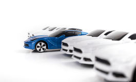 Toy Car Standing Out Among diverso o outro Toy Cars Fotos de Stock Royalty Free