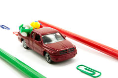 Toy car and stationery items Stock Photos
