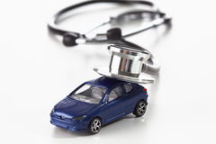 Toy car and stethoscope on white background Royalty Free Stock Images