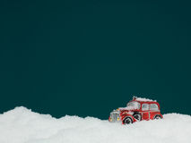 Toy car stuck in snow stock photos