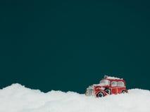 Toy car stuck in snow Stock Photos