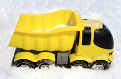 Toy car stuck in snow. On cold winter day Stock Photography