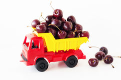 Toy car with a sweet cherry Royalty Free Stock Photo