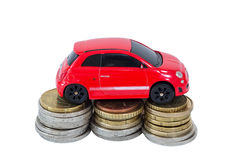 Toy car on top of stacks of coins Stock Images