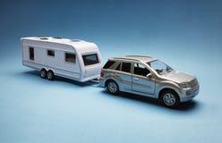 Toy car towing a caravan Royalty Free Stock Image