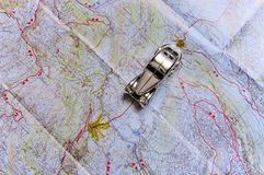 A toy Car, travels on a road map Royalty Free Stock Image