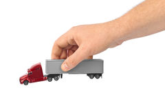 Toy car truck in hand. Isolated on white background Royalty Free Stock Photo