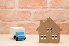 Toy car truck and house in front of brick wall. Stock Photos