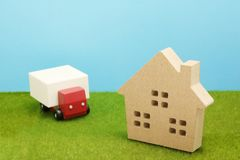 Toy car truck and house on green grass. Royalty Free Stock Photo