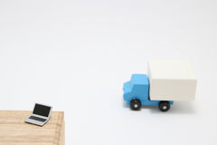Toy car truck and laptop on white background. Royalty Free Stock Images
