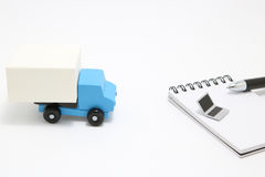 Toy car truck and laptop on white background. Royalty Free Stock Image