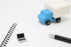 Toy car truck and laptop on white background. Royalty Free Stock Photo