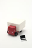 Toy car truck and miniature laptop on white background. Royalty Free Stock Image